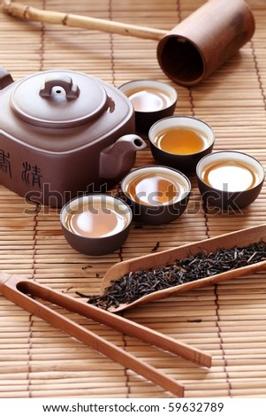 Set of China tea on bamboo mat. - stock photo