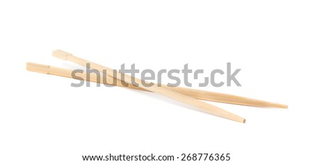 Set of chinese wooden chopsticks sticks isolated over the white background - stock photo