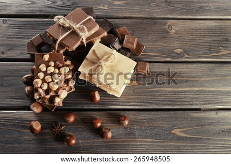 Set of chocolate with hazelnut on wooden table, top view - stock photo