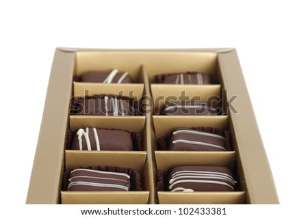 set of chocolates in a box on white background - stock photo