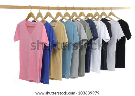 Set of Choice of man clothes of different colors on wooden hangers - stock photo
