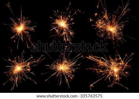 Set of Christmas sparkler on black background. - stock photo