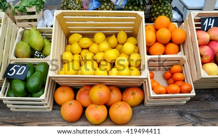 Set of citrus fruits from tangerines, kumquats, oranges and lemons at the local farm market - stock photo