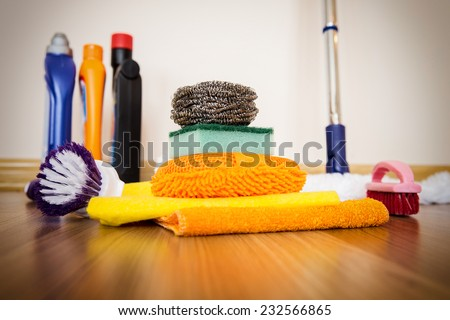 Set of cleaning equipment on a wooden floor - stock photo