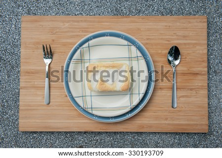 Set of Coconut cheese cake with spoon and fork on wooden board, Bakery food place one wood dish