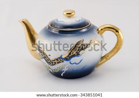 Set of coffee. Milk jug. Blue-eyed, golden dragon pattern. - stock photo