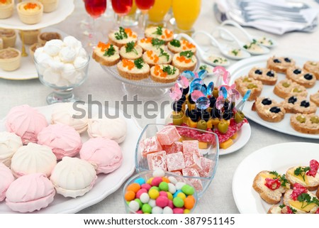 Set of cold snacks, canape, beverages and dessert, closeup - stock photo