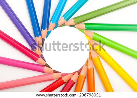set of color pencils in shape of sun on white background - stock photo