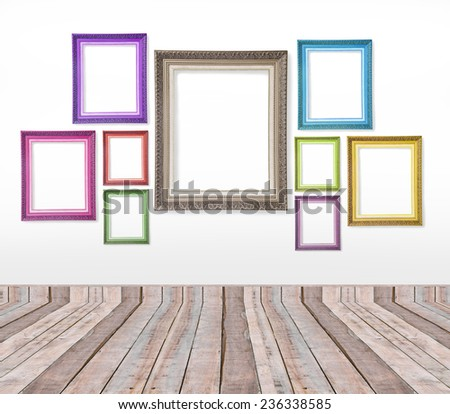 Set of color vintage picture frames on the wall inside the room - stock photo