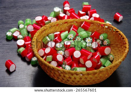 set of colored candies in a bowl handmade - stock photo