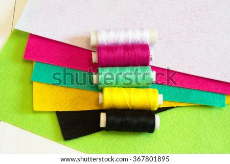 Set of colored felts and threads