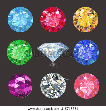 Set of colored gems isolated on dark background