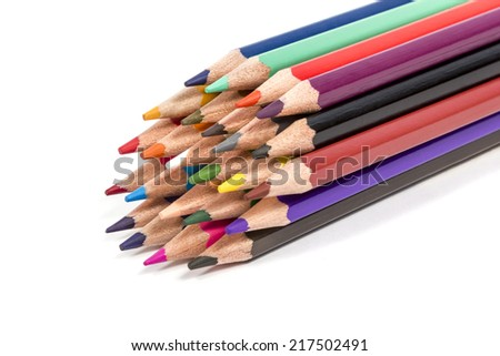Set of colored pencils tied up in a pack isolated on white background
