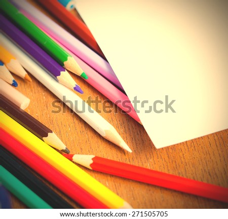 set of colored pencils with white paper. shallow depth sharpness. - stock photo
