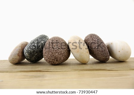 Set of colored stones on a wood board - stock photo