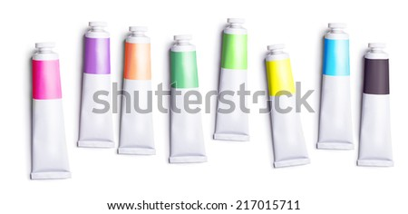 set of colored tubes with a paint on a white background - stock photo
