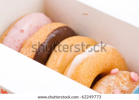 Set of colorful and delicious donut in paper box - stock photo