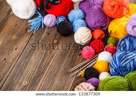 Set of colorful ball of yarn make frame - stock photo