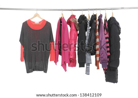 Set of colorful clothes hanging on clothes rack - stock photo