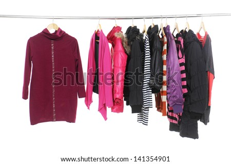 Set of colorful clothes hanging on clothes rack