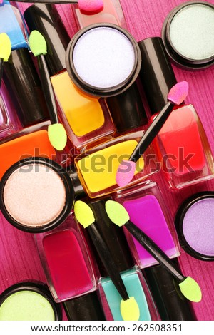 Set of colorful cosmetics on pink wooden table background - stock photo