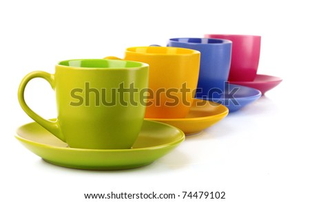Set of colorful cups on white background - stock photo