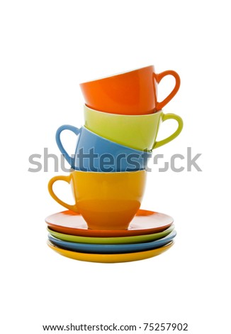 Set of colorful cups pyramid isolated on white background - stock photo
