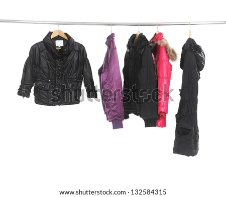 Set of colorful female colorful coat on Hangers - stock photo