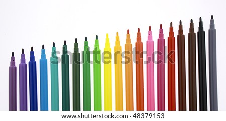 set of colorful markers arranged at an incline