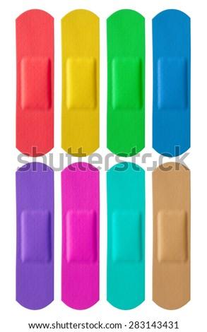 Set of colorful medical bandages isolated on white background - stock photo