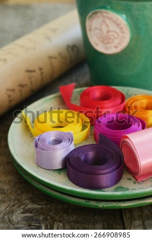 Set of colorful ribbons and wrap paper for decoration and wrapping