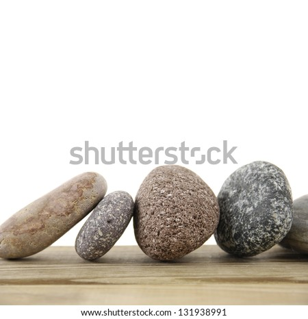 Set of colorful stones on a wood board - stock photo