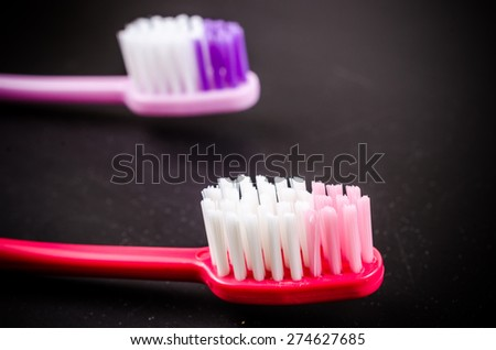 Set of colorful toothbrushs on blackboard - stock photo