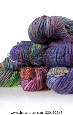 Set of colorful wool yarn balls. Hanks are set out in a pile. - stock photo
