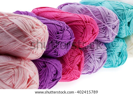 Set of colorful wool yarn wrapped in hanks. Close-up