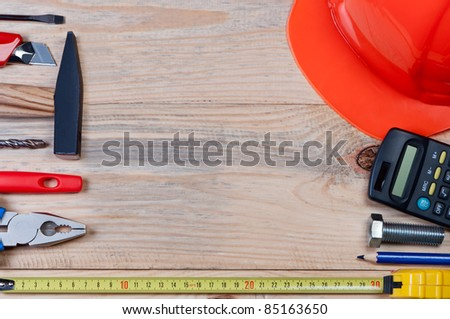 Set of construction tools on wooden board. Concept of building and repairing. - stock photo