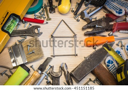 Set of construction tools, the tools lie around, center free, composition power tools. House of nails, hobnails