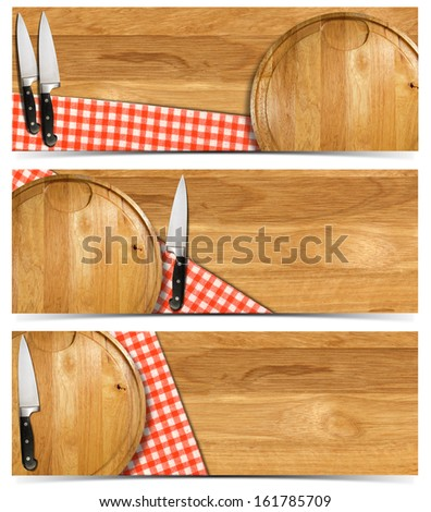 Set of Cooking Banners / Cooking banners with round cutting board, red checked tablecloth on wooden table and kitchen knife isolated on white - stock photo