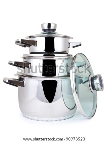 Set of cooking pots, against a white background. - stock photo