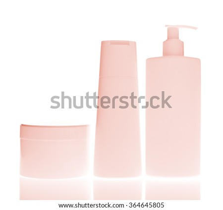set of cosmetic bottles isolated on white background - stock photo