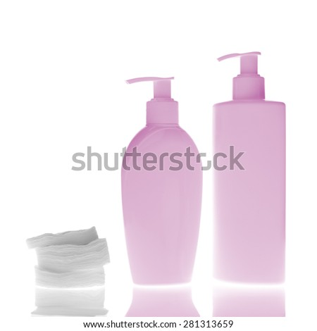 set of cosmetic bottles with cleaning pads isolated on white background - stock photo