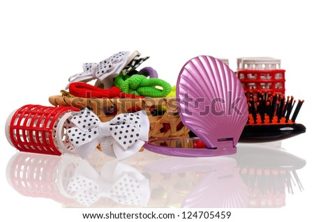 Set of cosmetics - hairbrush, hair curlers and small mirror isolated on white background - stock photo