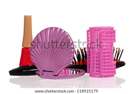 Set of cosmetics - nail polish, hairbrush, hair curlers and small mirror isolated on white background - stock photo