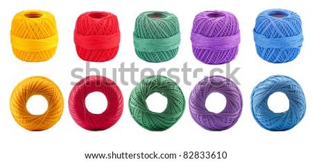 Set of cotton spools against white background - stock photo