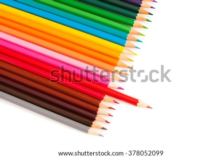 Set of crayons with pulled red pencil, isolated on white background - stock photo