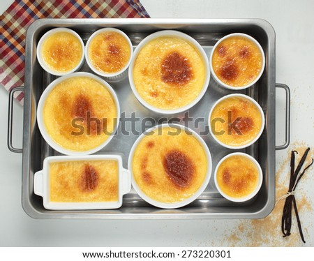 Set of creme brulee in baking dishes. Top view - stock photo