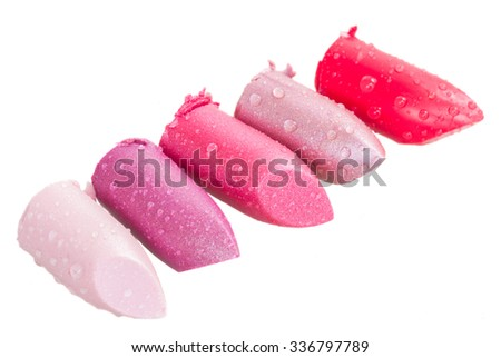 set of crushed pink lipsticks isolated on white background