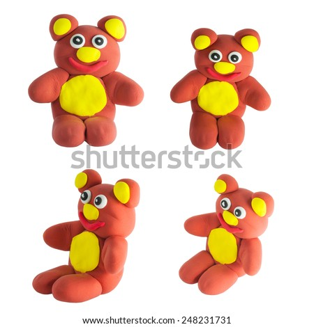 Set of cute brown bear made from plasticine with clipping path on white - stock photo
