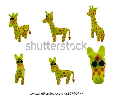 set of cute yellow giraffe made from plasticine - stock photo