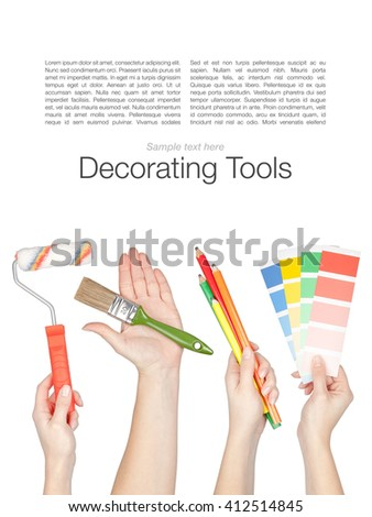 set of decorating and house renovation tools in a hands isolated on white background - stock photo